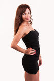 Glamour girl in black dress posing Stock Image