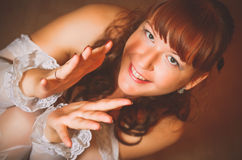 Glamour girl claps her hands. Stock Photography