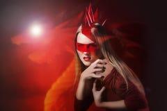 Glamour girl dragon symbol 2012. Glamorous girl with the red dragon symbol plastic mane 2012 Stock Photo