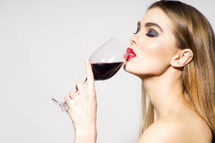 Glamour girl drinking wine Stock Photography