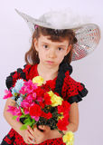 Glamour girl with flowers Stock Image