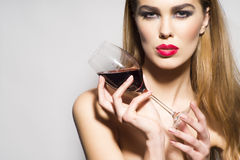 Glamour girl with glass of red wine Royalty Free Stock Photography
