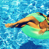 Glamour girl with inflatable circle in pool party Summer Style Stock Images