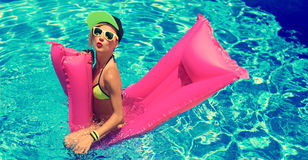 Glamour girl with inflatable mattress in the pool hot summer par Royalty Free Stock Photography