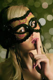 The glamour girl in a mask. In night club Royalty Free Stock Photography