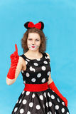 Glamour girl in party costume on blue background posing Royalty Free Stock Photos