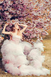 Glamour girl in pink blossom Royalty Free Stock Images