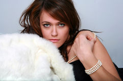 Glamour Girl With Pretty Eyes, Fur and Pearls Stock Photos