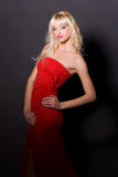 Glamour girl in red dress Stock Photos