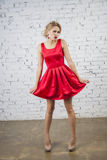 Glamour Girl in red party dress Royalty Free Stock Photo