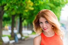 Glamour girl's face with red lips Royalty Free Stock Photos