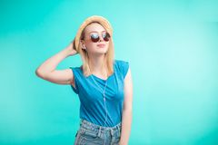 Glamour girl in sunglasses posing to the camera Stock Photo