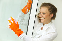 Glamour girl washing the window Royalty Free Stock Photo