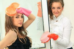 Glamour girls washing the window Royalty Free Stock Image