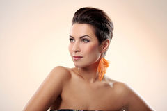 Glamour and gorgeous brunette with feather earring Stock Images
