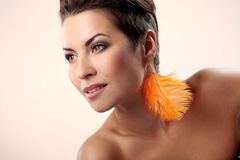 Glamour and gorgeous brunette with feather earring Royalty Free Stock Photo