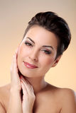 Glamour and gorgeous brunette touching her face Royalty Free Stock Photos