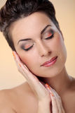 Glamour and gorgeous brunette touching her face Stock Photos