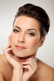 Glamour and gorgeous brunette touching her face Royalty Free Stock Images