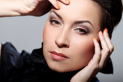 Glamour and gorgeous brunette touching her face Stock Image
