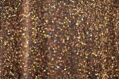 Glamour gouden fonkelende achtergrond Vaag schitter textuur stock foto