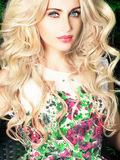 Glamour lady with long curly hair Royalty Free Stock Photos