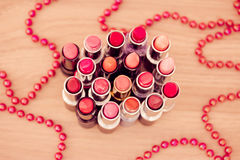 Glamour Lipsticks And Red Beaded Necklace Royalty Free Stock Photo