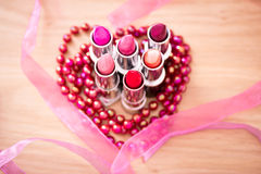 Glamour Lipsticks And Red Beaded Necklace Stock Image