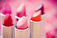 Glamour lipsticks in different colors Stock Images