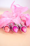 Glamour lipsticks in different colors Stock Photos