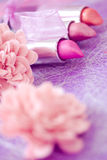 Glamour lipsticks and flower petals Stock Images