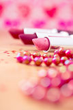 Glamour lipsticks and red beaded necklace Royalty Free Stock Images
