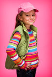 Glamour Little Girl. On pink Background Stock Photos