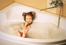 Glamour little girl in the bathtub Royalty Free Stock Image