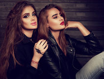 Glamour makeup two women with long hair style sitting on street Royalty Free Stock Images