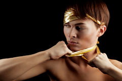 Glamour Man. With Gold Bandage. Isolated on Black Background Royalty Free Stock Photography