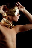 Glamour Man. With Gold Bandage and Jewelry. Isolated on Black Background Stock Photo