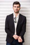 Glamour man. Confident man in his perfect look. Young smiling, trendy man is looking at the camera Stock Images