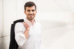 Glamour man. Confident man in his perfect look. Young smiling, trendy man is looking at the camera Royalty Free Stock Image