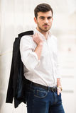 Glamour man. Confident man in his perfect look. Young trendy man is looking at the camera Royalty Free Stock Images