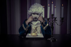 Glamour, man dressed in rococo style, concept of wealth and pove Stock Image
