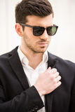 Glamour man. Portrait of young trendy man with black glasses Royalty Free Stock Photo
