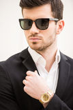 Glamour man. Portrait of young trendy man with black glasses Royalty Free Stock Photography
