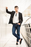 Glamour man. Portrait of young trendy man with is posing in modern office Stock Photos