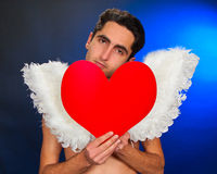 Glamour man with white wings. Portrait of glamour man with white wings and heart Stock Photo