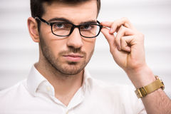 Glamour man. Young handsome  self-confident man with glasses. Close-up Stock Photo