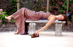 Glamour Model!. Glamor model lying on an old, antique bench stock images