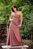 Glamour Model!. Pretty bridesmaid relaxing outside in the sun royalty free stock image