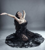Glamour model in black lace dress Stock Images