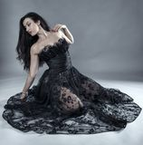 Glamour model in black lace dress Royalty Free Stock Photo